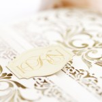 custom gold foil monogram on paper clasp