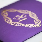 gold design invitation on purple