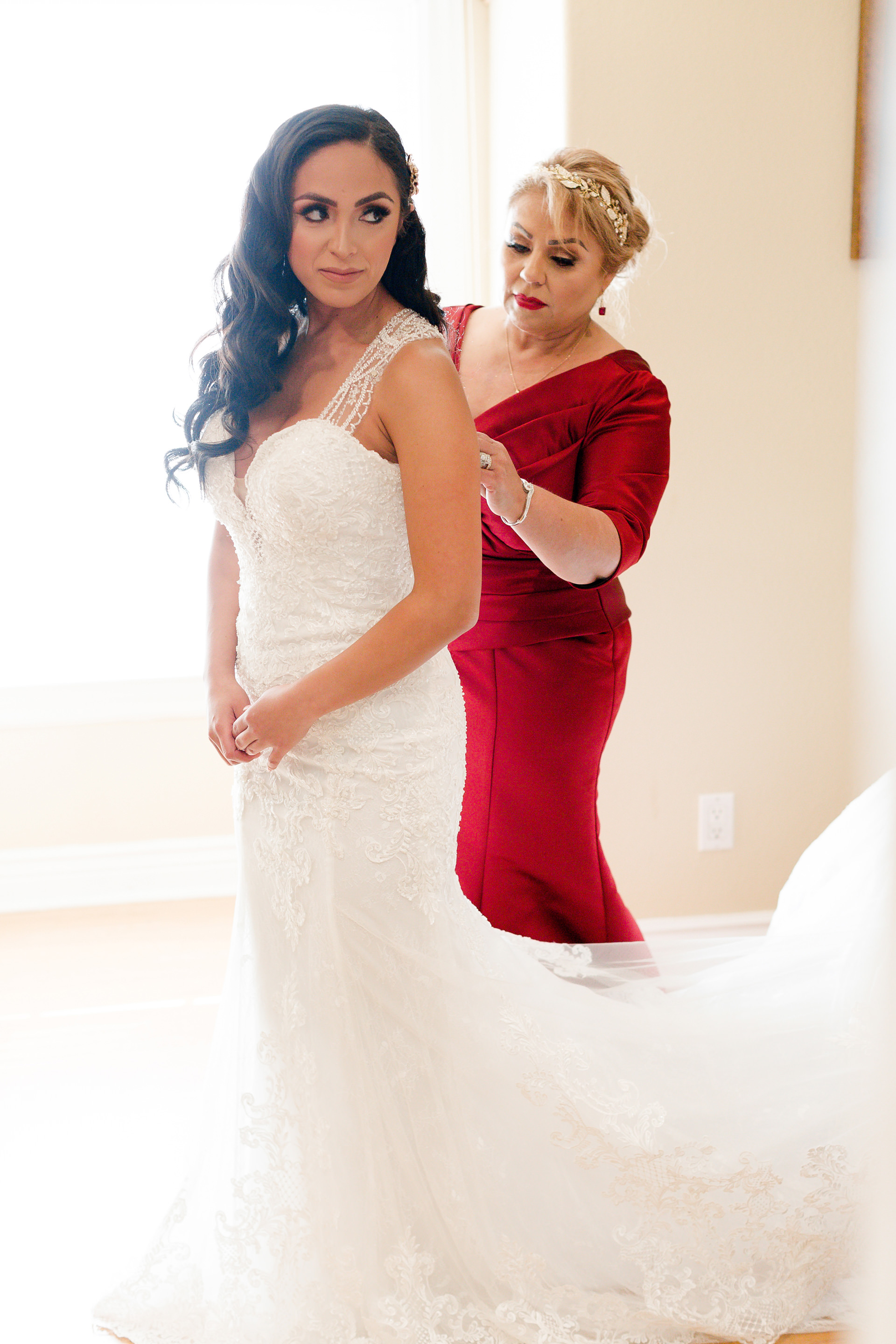 mother-of-the-bride helps her daughter dress