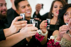 family of the grooms toasting on the wedding day