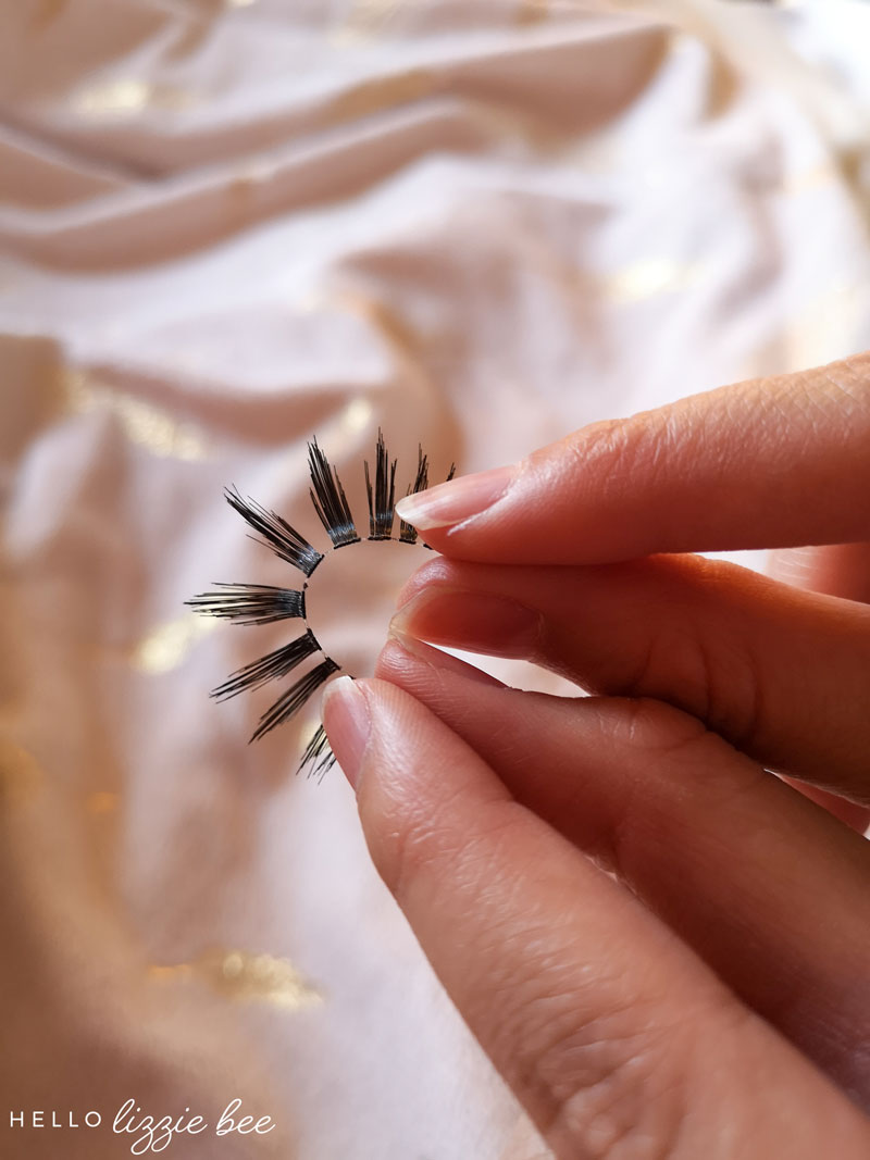 Bending false lashes to make easier to put on