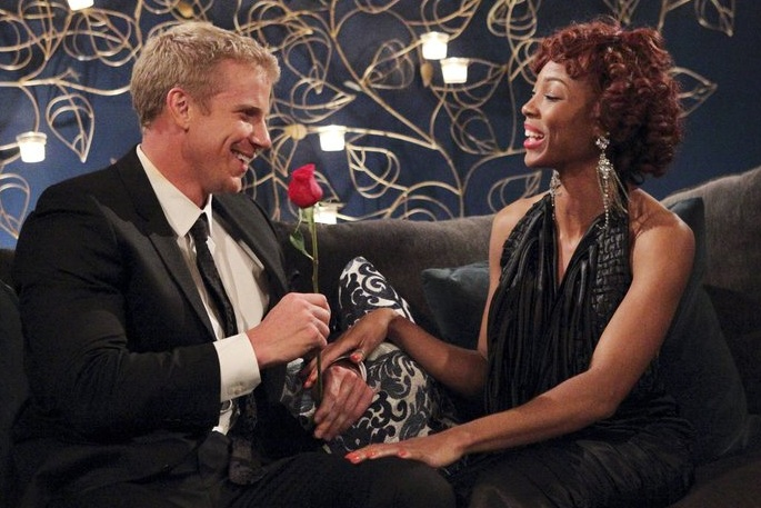 Sean Lowed on the Bachelor giving out roses.