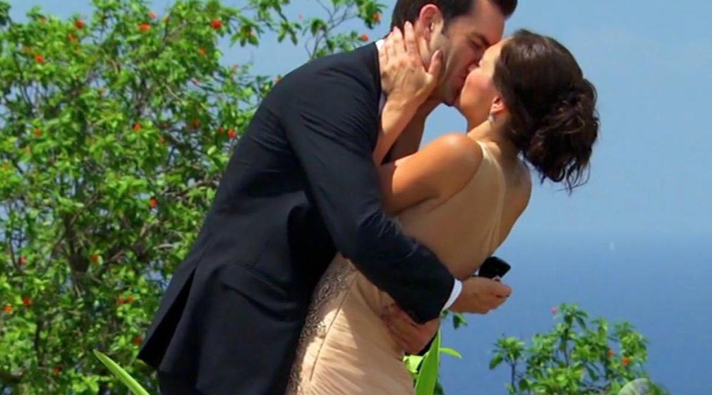 Chris and Desiree kiss after he proposes to her on the Bachelorette final rose.