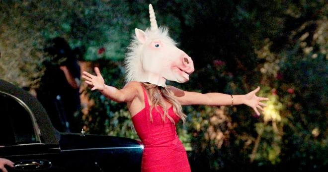JoJo Bachelorette meets Ben Higgins wearing a unicorn mask.