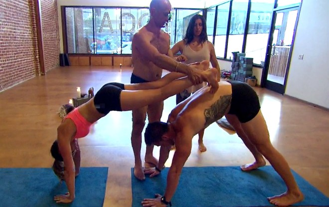 Chase and JoJo do yoga on the Bachelorette.