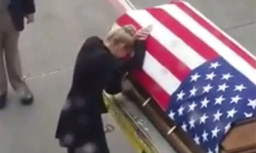 Grieving Army Widow Meets Husbands Coffin At Airport