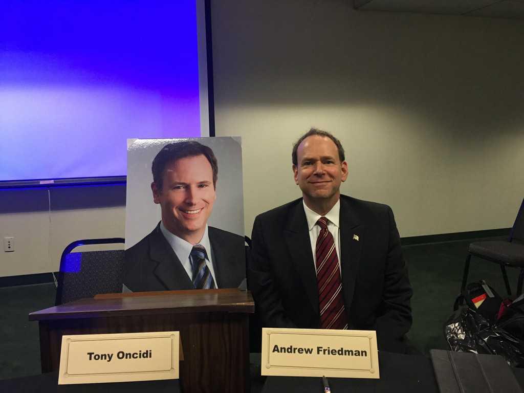 Andrew H. Friedman presenting beside likeness of Tony Oncide to Santa Clara Bar Association.