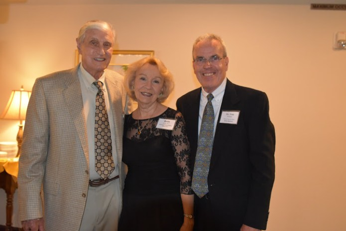 Grand Sponsor, Ralph Scriba, enjoys the major donor reception with Britt Huff, H.E.L.P. Executive Director, and Tom Paulsen, M.D., H.E.L.P. Board Chair.