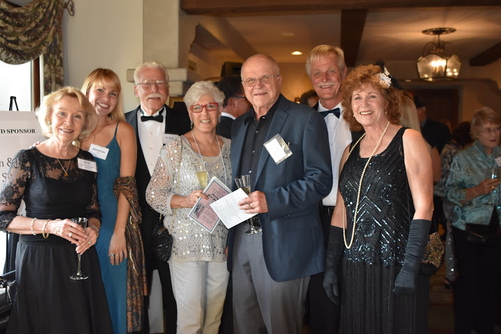 Laura Kauls, center, H.E.L.P. Board Treasurer, with Britt, Hana, and Ken Huff; Juris Kauls, and Dan & Vicki Neesby.