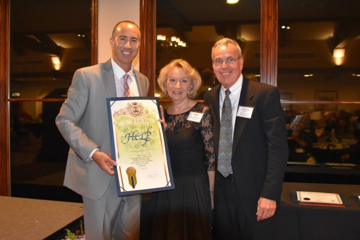 Steve Napolitano, L.A. County Board of Supervisors, presents 20th Anniversary Proclamation to Britt Huff, Ph.D., H.E.L.P. Executive Director, and Tom Paulsen, M.D., H.E.L.P. Board Chair.