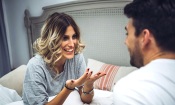 Couple talking on bed