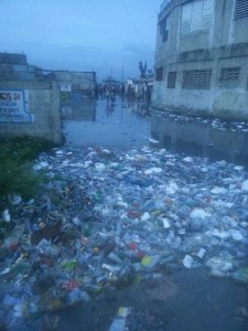 Garbage and sewage in flood water near Helping Haiti clinic
