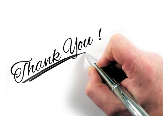 Hand Writing Thank You With Pen