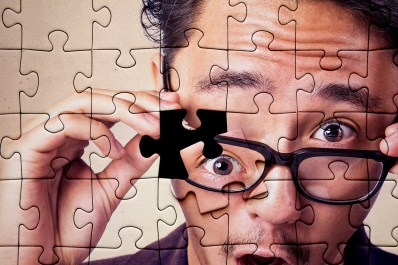 Man's face in puzzle pieces