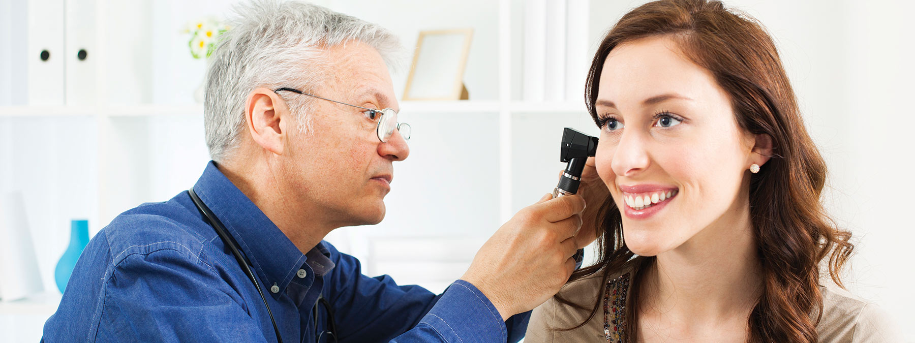 woman getting her hearing checked by an audiologist