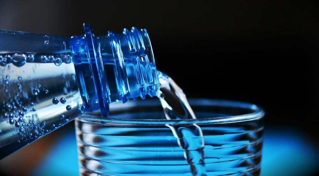 hemp bottle pouring water