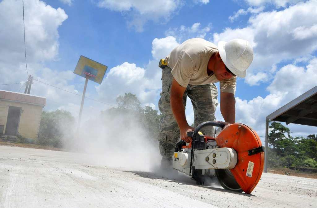 construction worker cutting concrete