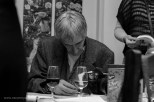 Hendrik Mentz signing a copy of his indie-published book, 'Enter' | photo credit: Oscar O'Ryan