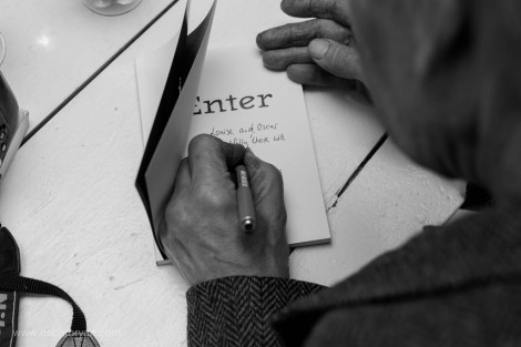 Hendrik Mentz signing a copy of 'Enter' purchased by Louise Coetzer and Oscar O'Ryan   photo credit: Oscar O'Ryan