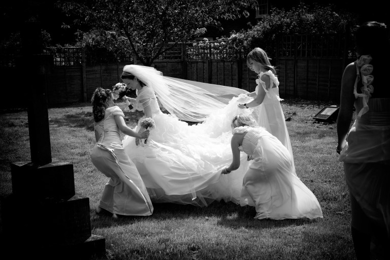 A black and white image of the bride and bridesmaids preparing for the wedding.