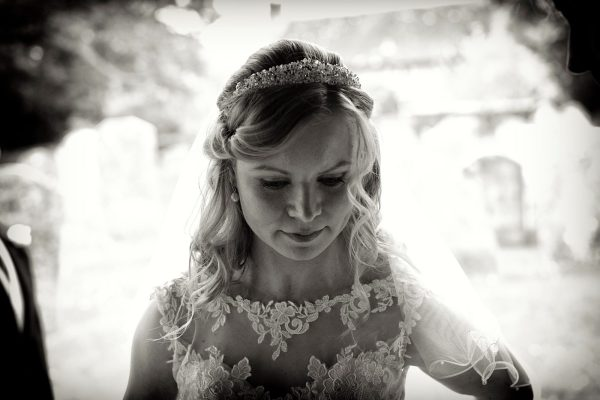 Black and white photograph of bride by Surrey Wedding Photographer Henry Wells
