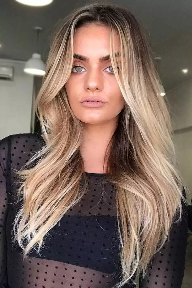 dirty-blonde-hair-styles-wavy-styling-long-layered-brown-balayage