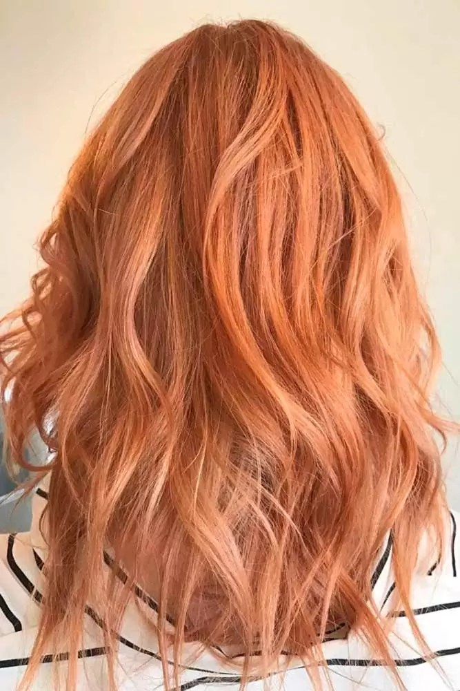 sweet-strawberry-blonde-hair-copper-blonde-curly-medium-balayage