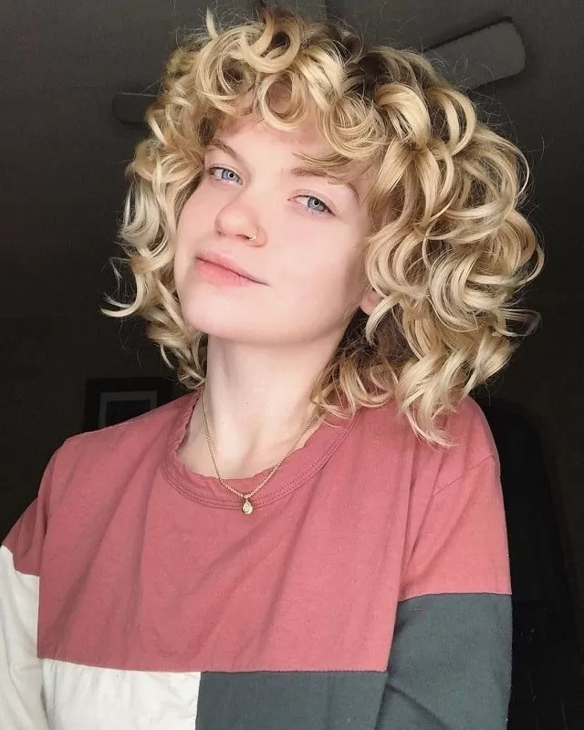 Curly Blonde Hair with Blue Eyes