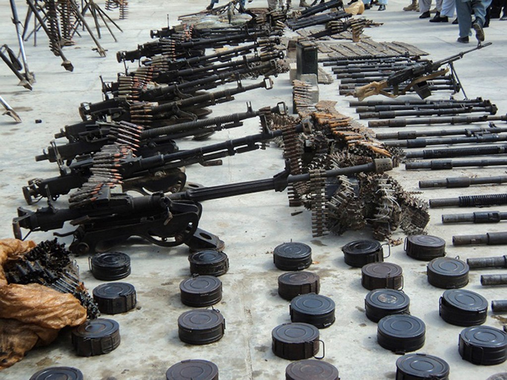 A weapons cache, discovered following a two-day operation by the Afghan National Directorate of Security, is seen on display for the media in Kandahar City