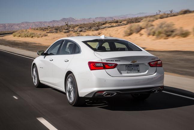 2016-Chevrolet-Malibu-20T-Premier-rear-three-quarter-in-motion