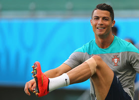 SALVADOR, BRAZIL - JUNE 15: Cristiano Ronaldo stretchs during the Portugal training session ahead of the 2014 FIFA World Cup Group G match between Germany and Portugal held at the Arena Fonte Nova on June 15, 2014 in Salvador, Brazil. (Photo by Martin Rose/Getty Images)