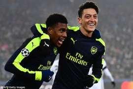 Mesut Ozil and Alex Iwobi