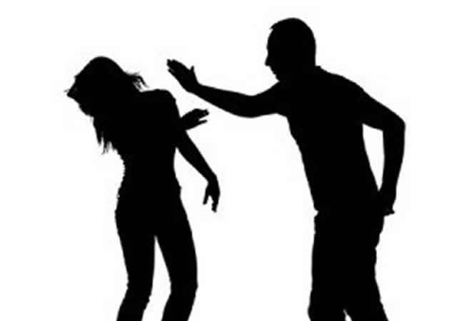silhoutte of man slapping woman