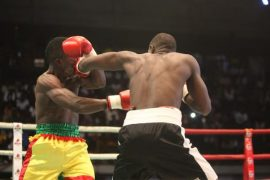 Alex Ekhorowa pummeling opponent in a boxing match