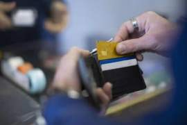 man pulls out bank card