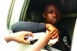 policeman collecting bribe