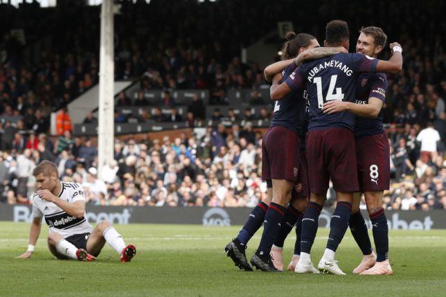Aubameyang and Ramsey celebrate a goal
