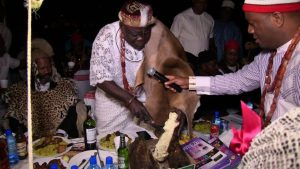 Chief Julius Osakwe, President of Ohaneze ndigbo South Africa chapter, cutting a roast tuber yam to mark the New Yam Festival (Iriji Ndi Igbo) in South Africa on Sunday, 07/10/2018.