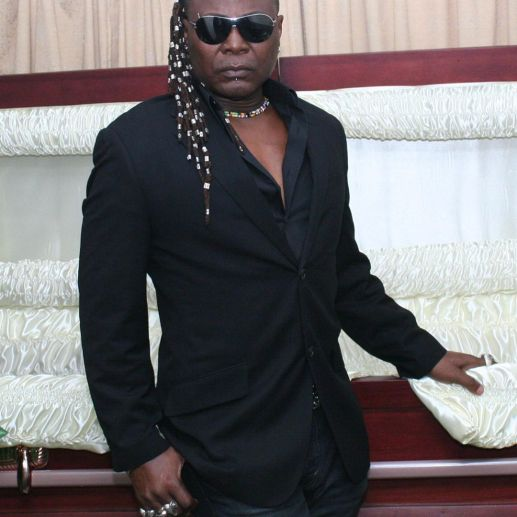 Charly Boy lampoons Nigeria while posing inside coffin in new photos