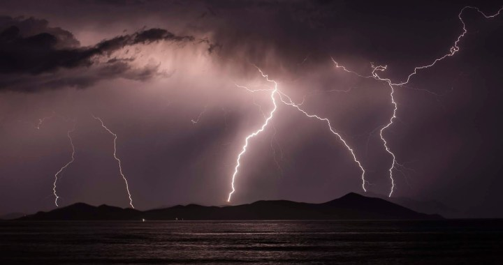 KOS, GREECE - JUNE 03:  Lightning strikes over the Greek Island of Pserimos on June 03, 2015 in Kos, Greece. Migrants are continuing to arrive on the Greek Island of Kos from Turkey who's shoreline lies approximately 5 Km away. Around 30,000 migrants have entered Greece so far in 2015, with the country calling for more help from its European Union counterparts.  (Photo by Dan Kitwood/Getty Images)