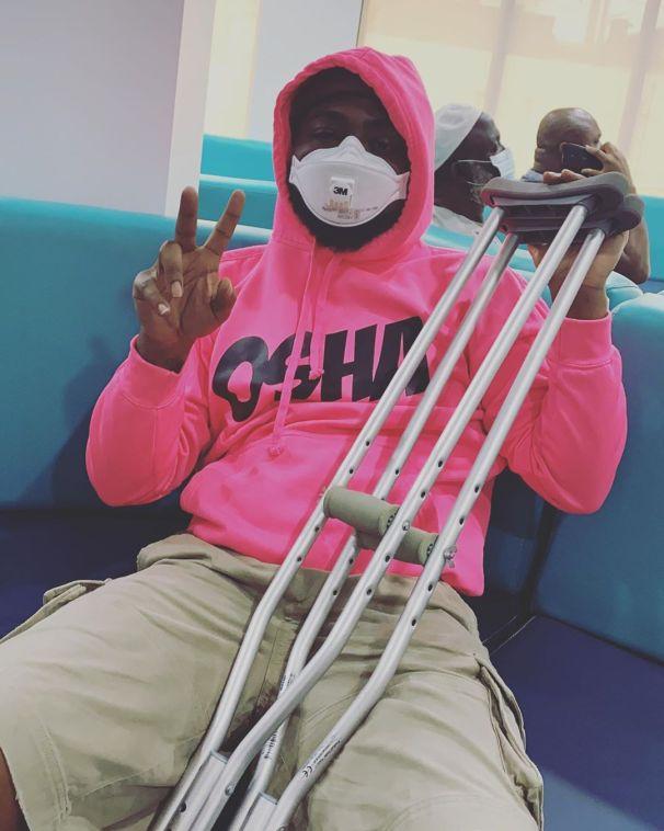 Davido on crutches