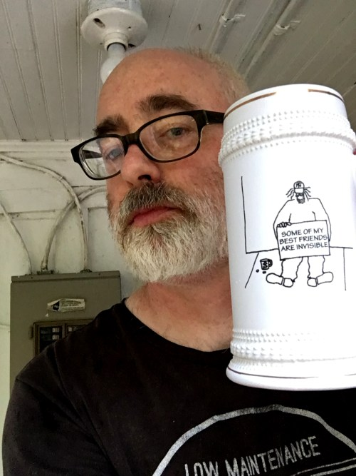 man holding large ceramic mug