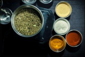 creole seasoning herbs in grinder