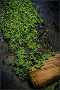parsley pesto with wooden spatula