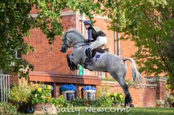 Chloe Mariani on Fire jumps into the garden at Hartpury House