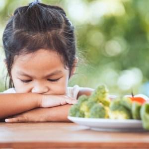 Girl refusing to eat vegetables