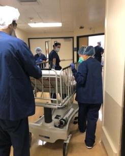 nurses pushing gurney