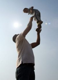 Dad tossing child in air