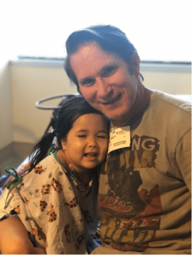 Smiling father with sick daughter