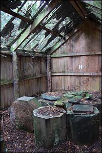 Stonework stored in a now leaking shed